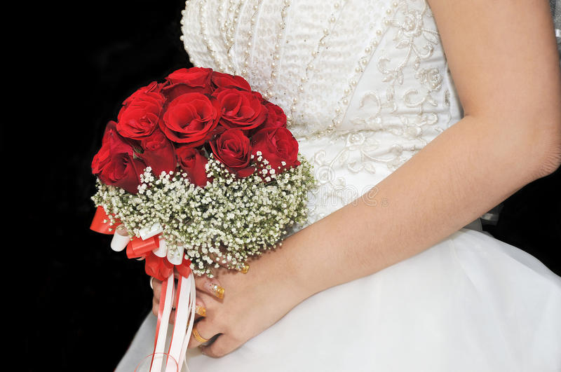 Bride's Bouquet. Of roses in hand royalty free stock images