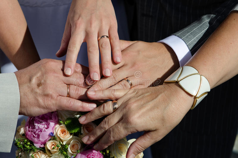 The bride`s bouquet assembled hands with rings. Wedding concept royalty free stock photo