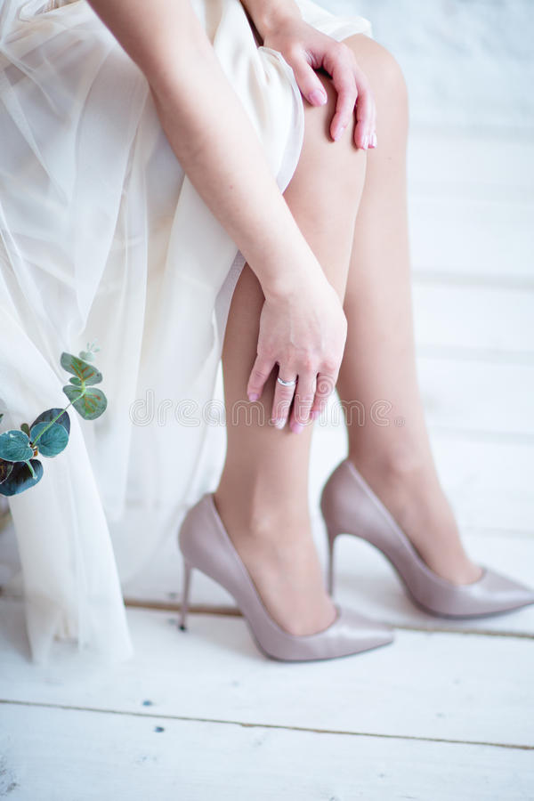 Bride`s feet in shoes. Bride dress shoes in the morning stock image