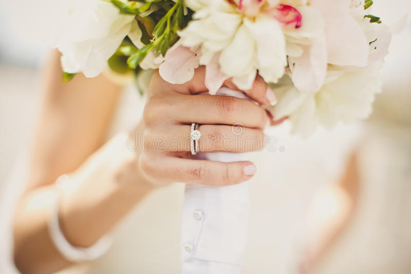 Bride's hands with flowers. Close up of bride's hands with flowers royalty free stock photos