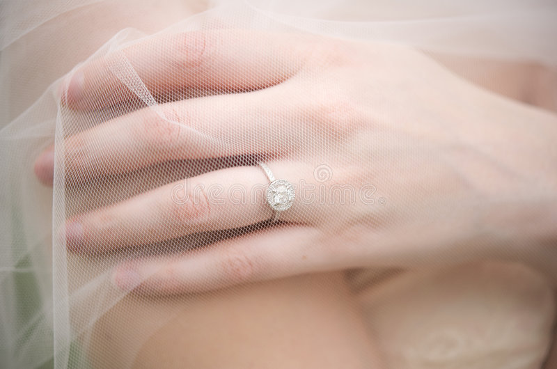 Bride's ring underneath a veil stock image