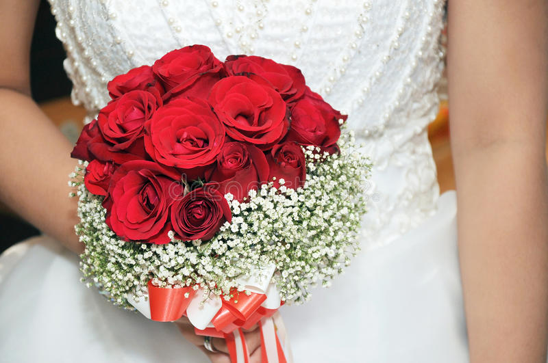Bride's rose bouquet. Wedding bride holding bouquet of roses royalty free stock photos