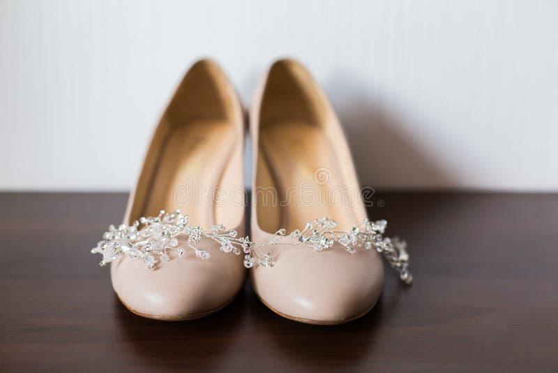 Bride`s wedding shoes. Bridal accessories stock image