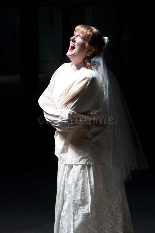 Bride Screaming in Straight Jacket royalty free stock photos