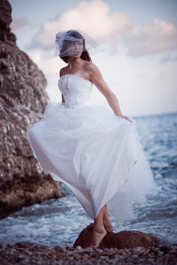 Bride at sea coast stock photos