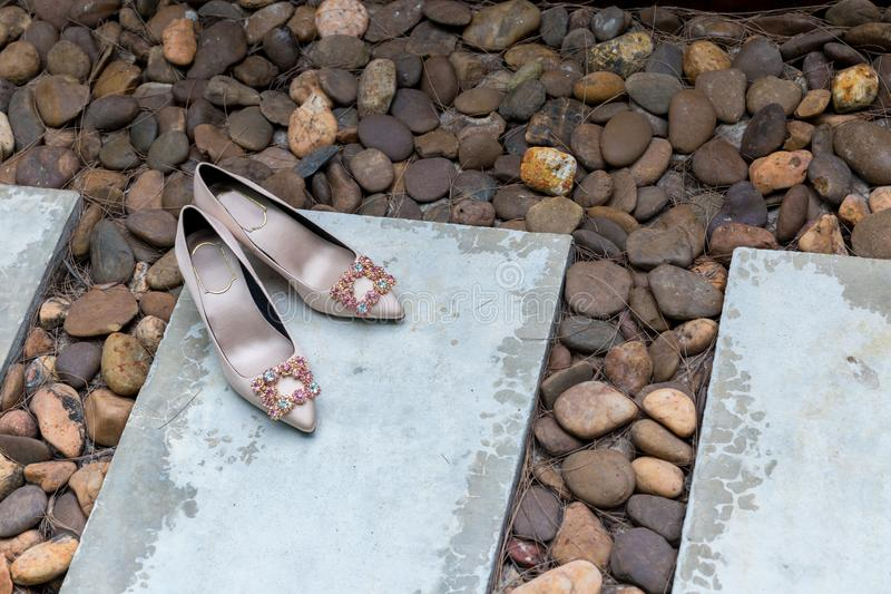Bride shoes place on the floor. wedding high heels on brown carpet .wedding bride fashion. costume of wedding clothes.  stock image