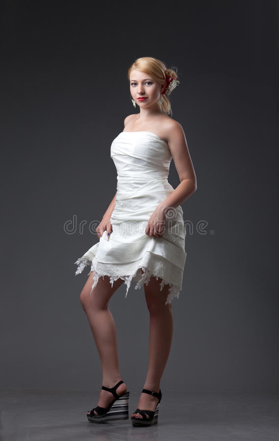 Bride in the short wedding dress stock images