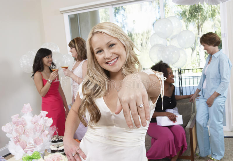 Bride Showing Her Engagement Ring At Hen Party Stock Image