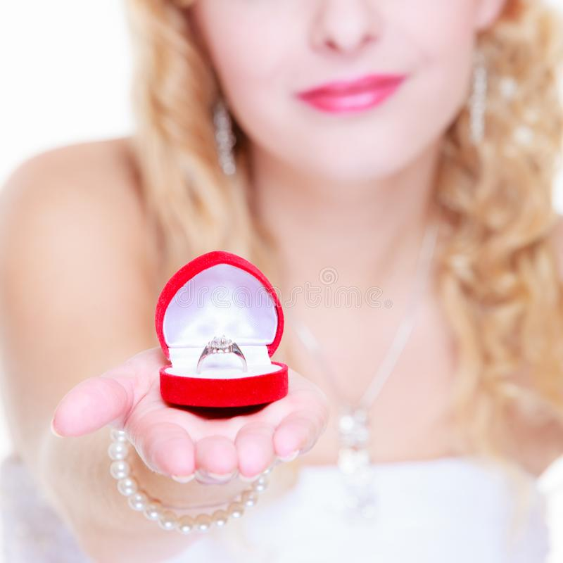 Bride showing proposal ring. Marriage, proposing, future wife concept. Bride wearing white long dress showing proposal ring stock photos