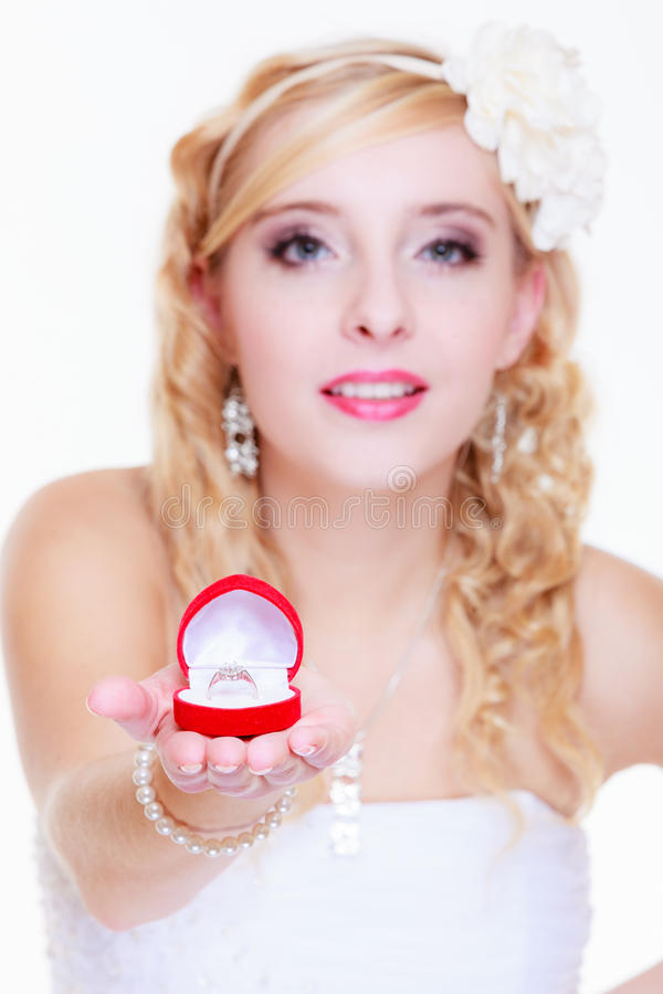 Bride showing proposal ring. Marriage, proposing, future wife concept. Bride wearing white long dress showing proposal ring royalty free stock photography