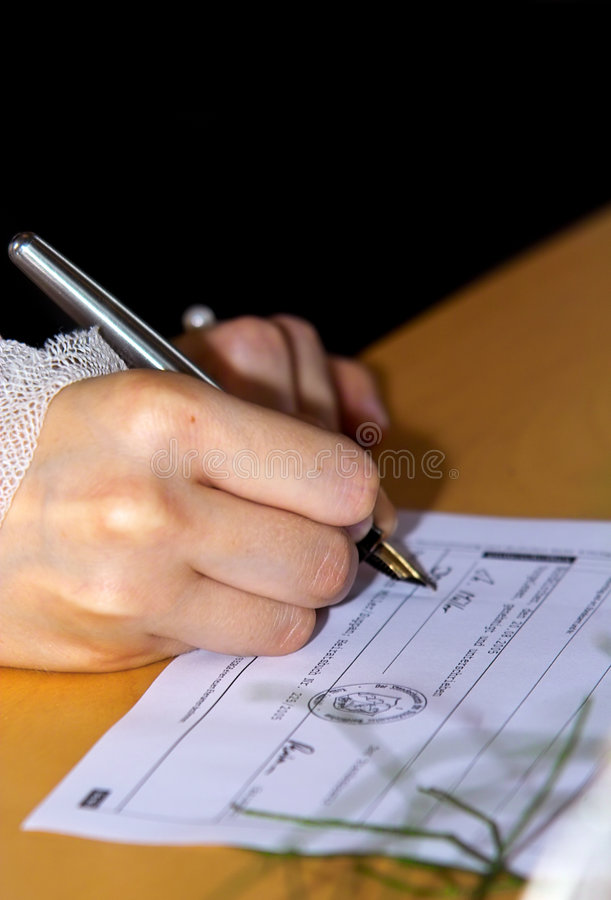 Bride Signing Stock Photography