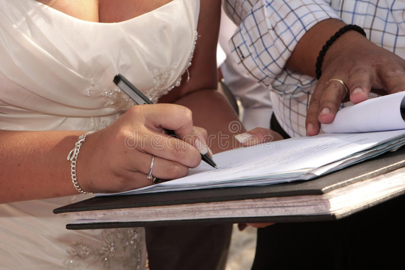 Bride signing register royalty free stock photos