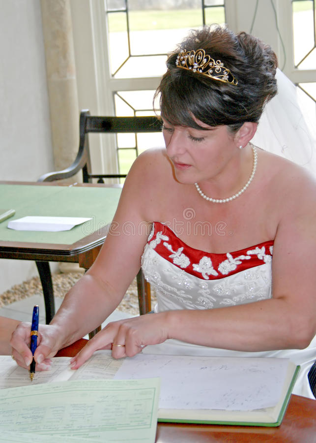 Bride Signing the Register royalty free stock photos