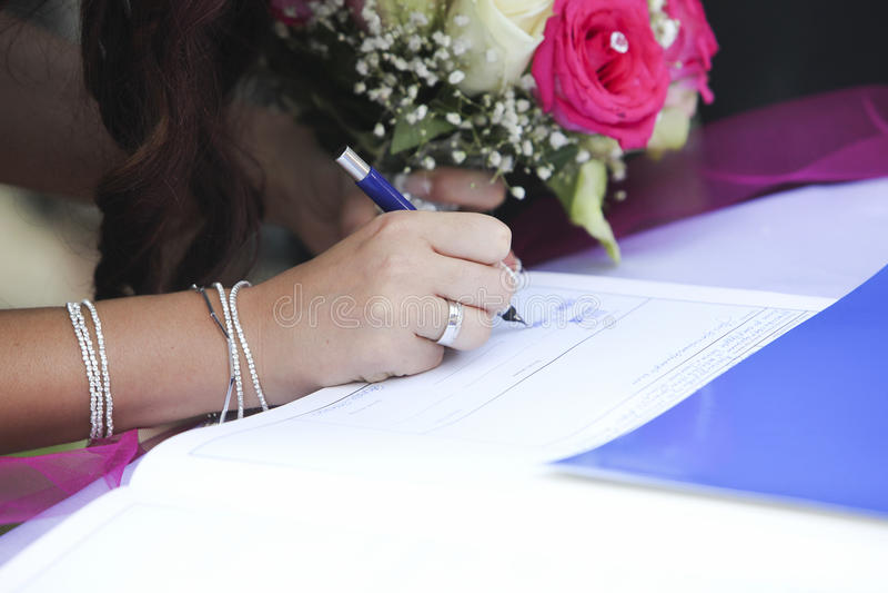 Bride signing wedding marriage register royalty free stock photos