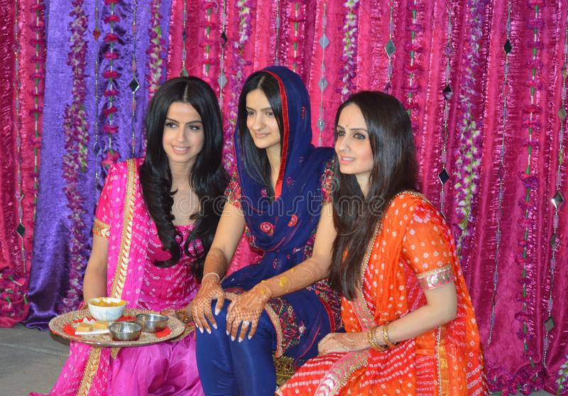 The Bride and 2 sister. Punjabi wedding function with Bride and her two sisters stock photography