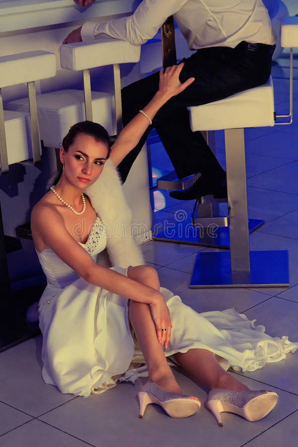 Download Bride Sitting On Floor Next To Bar Stock Image - Image: 22971825