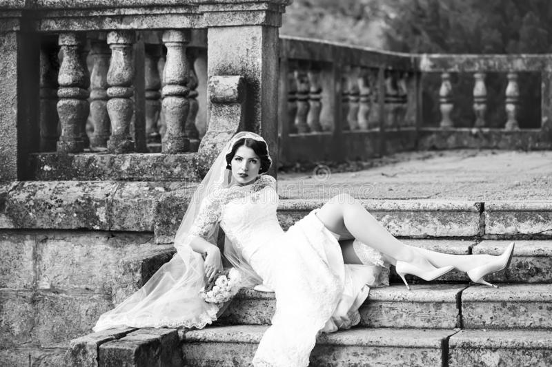 Bride sitting on stairs royalty free stock image