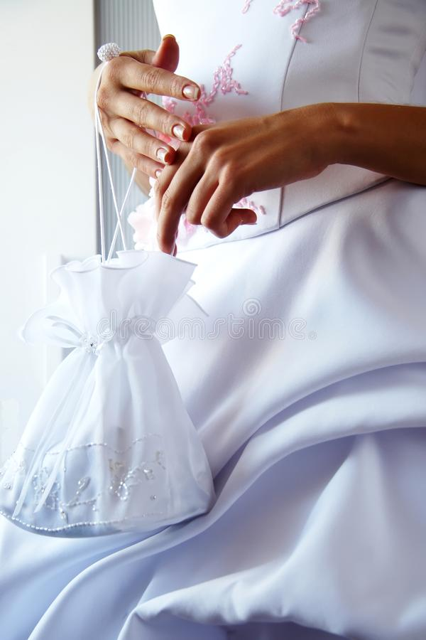 Bride with small bag in hands stock images