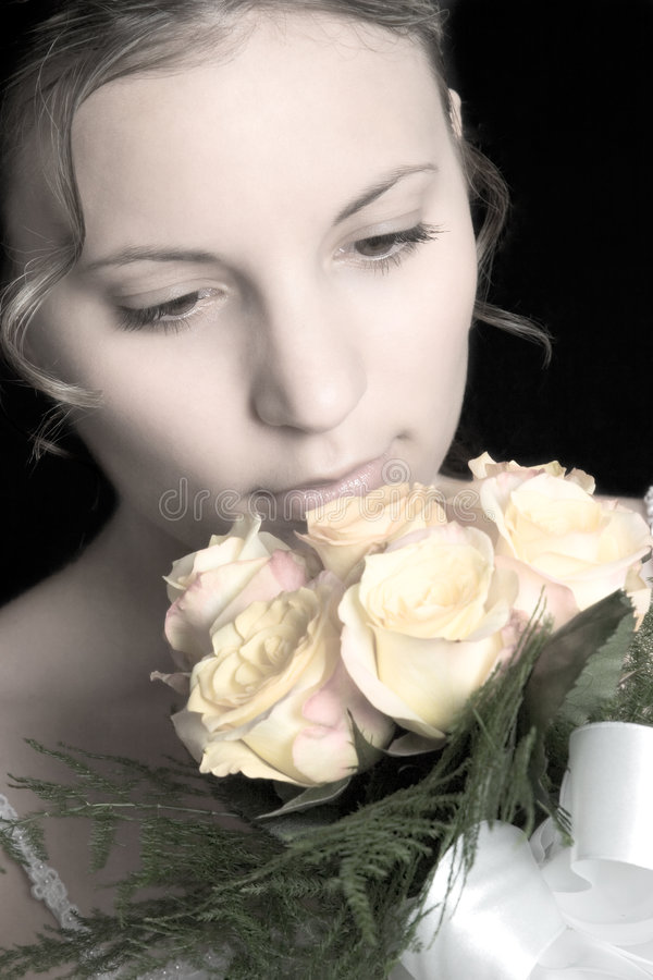 Bride Smelling Flowers royalty free stock images