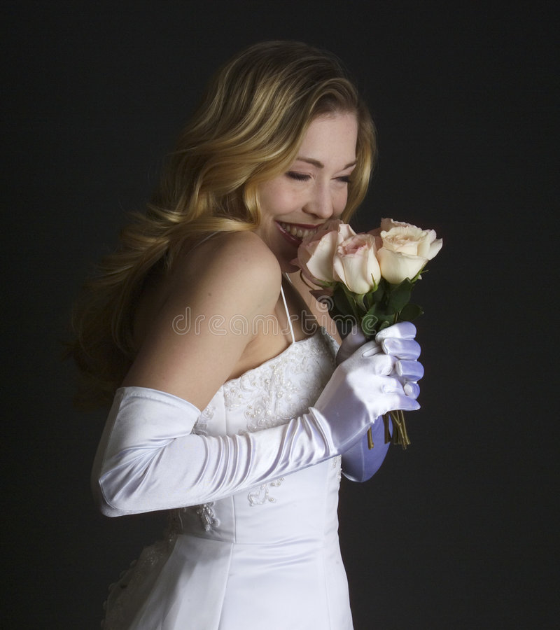Download Bride smelling her bouquet stock image. Image of girl, bouquet - 200953