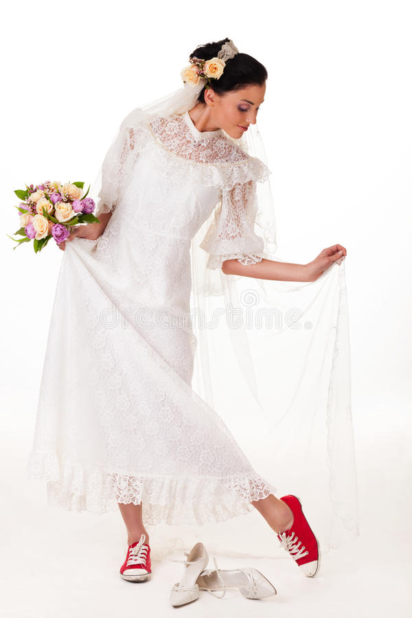 Bride in sneakers. Bride changing high heels into sneakers royalty free stock images