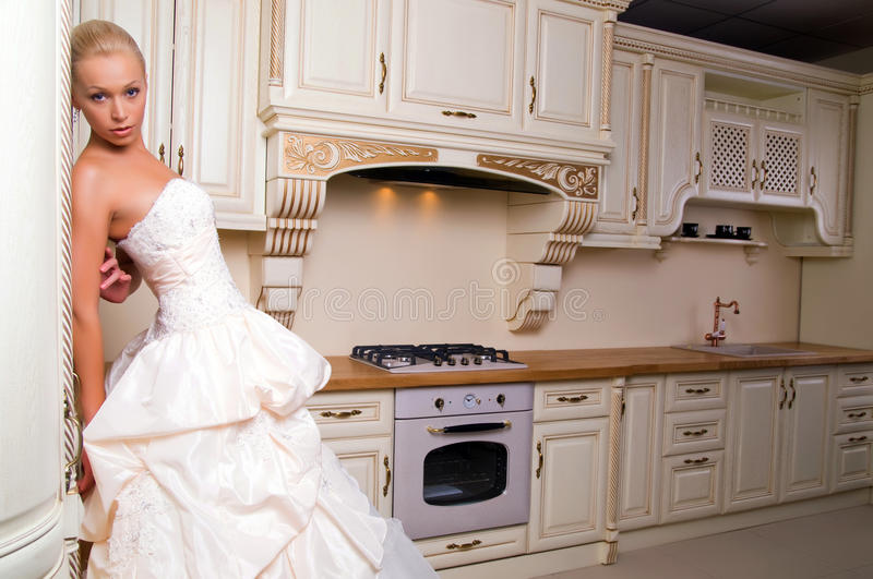 Bride Stands In The Kitchen Royalty Free Stock Images