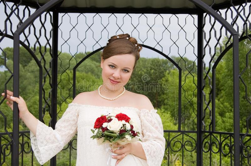 Download Bride In Steel Cage With Beautiful Bouquet Stock Photo - Image: 22840382
