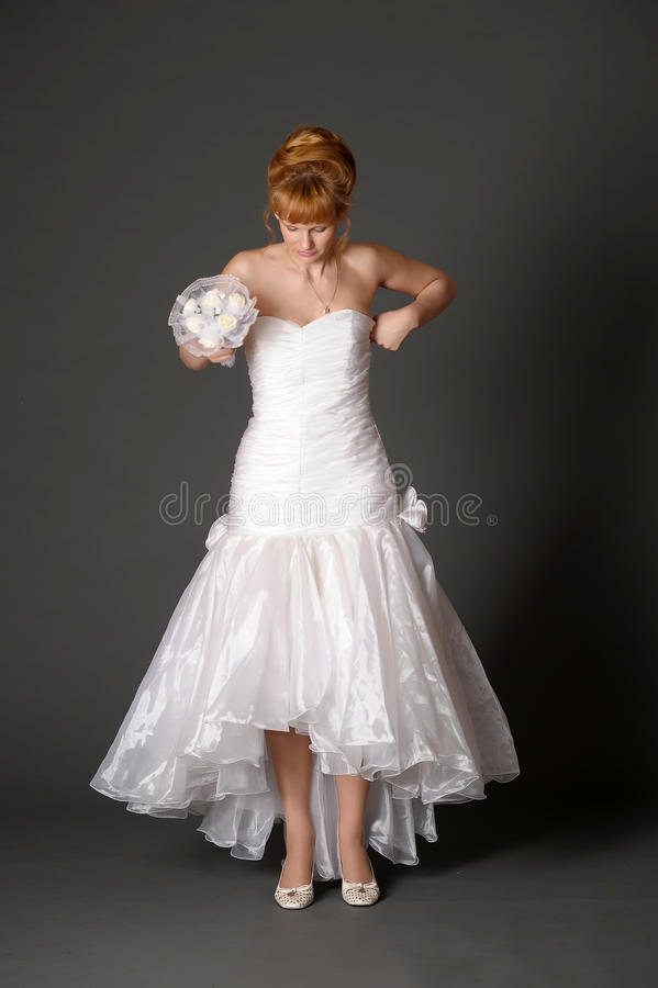 Bride in the studio. Bride in studio on a gray backgroundn royalty free stock images