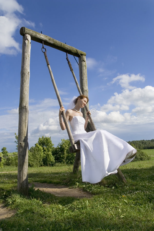 Download Bride on a swing stock image. Image of nature, bouquet - 5620549