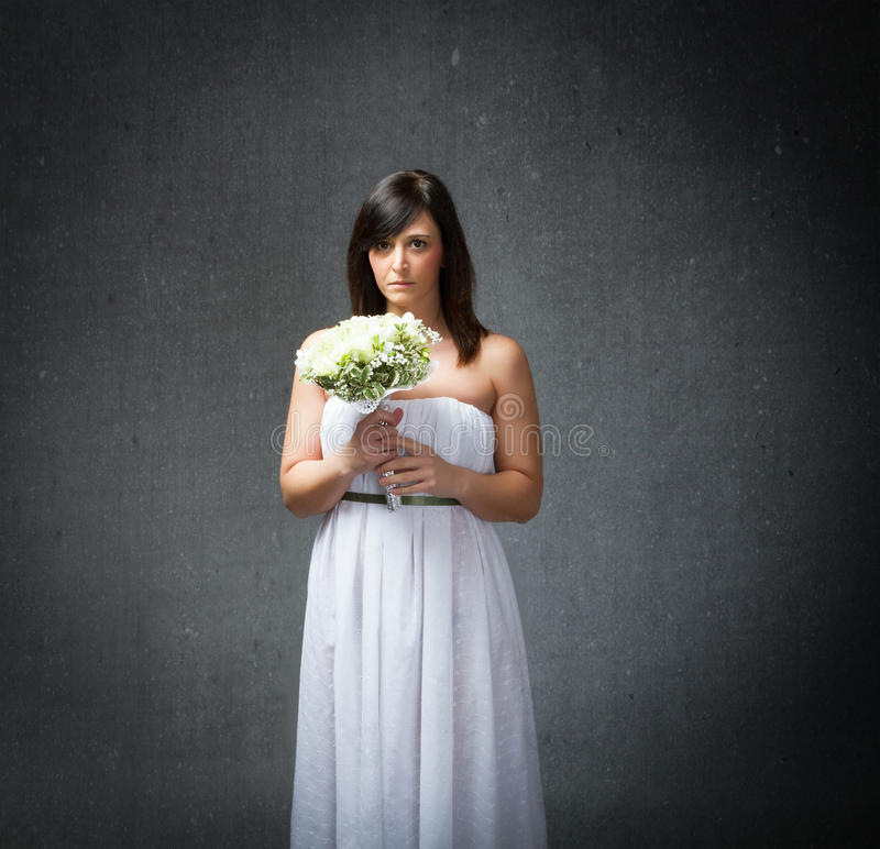 Bride terrify expression. People emotions and expressions in dark background royalty free stock image