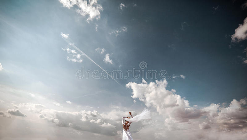 Bride on then sky. Bride on a background of blue and beautiful sky royalty free stock photography