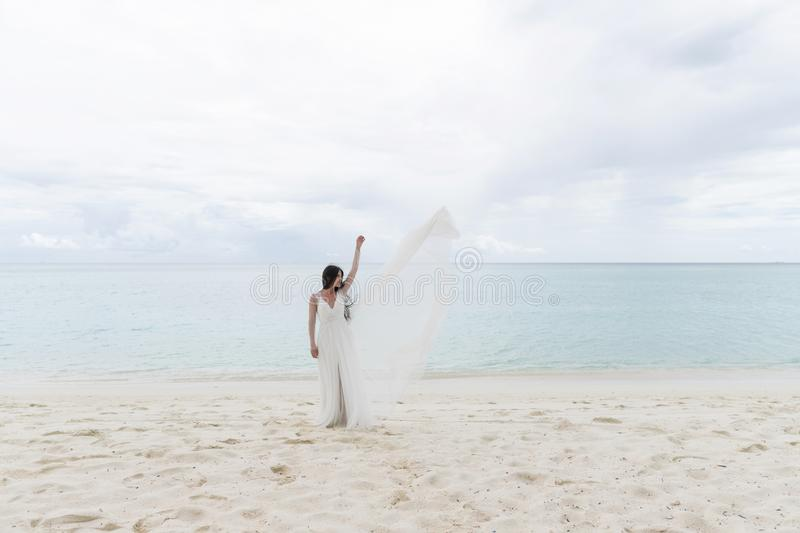 The bride throws a white dress in the air stock photo