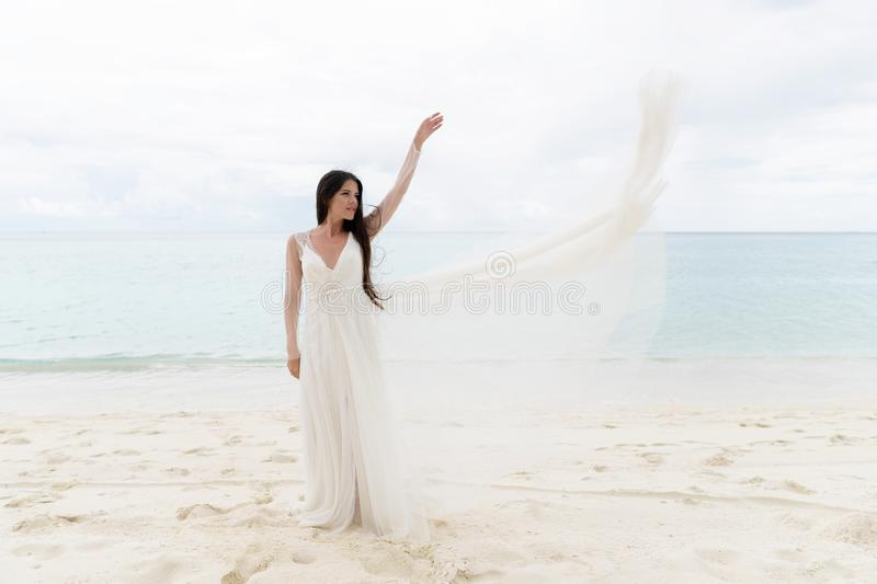 The bride throws a white dress in the air royalty free stock image