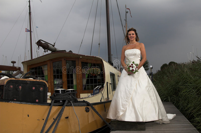 Bride with thunderclouds royalty free stock image