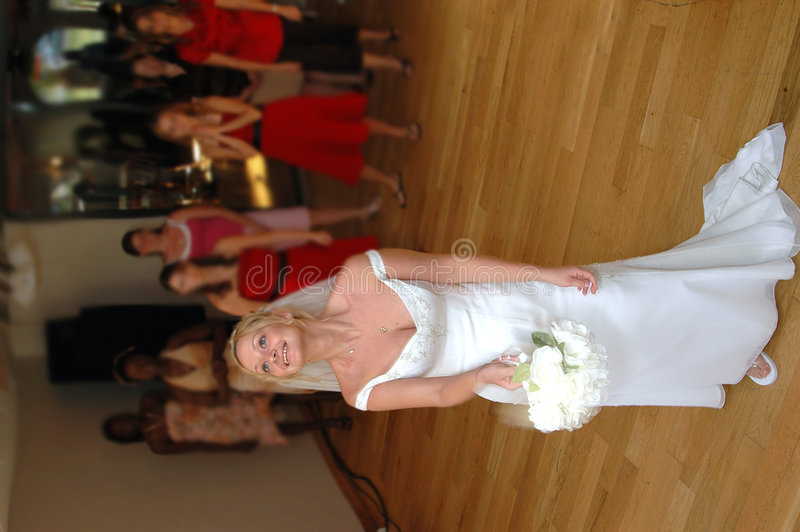 Bride tossing bouquet royalty free stock photos