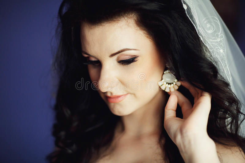 Bride trying on jewelry close-up royalty free stock photo