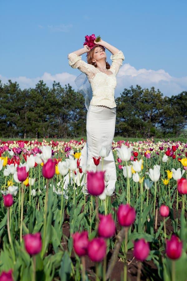 Bride in tulips field