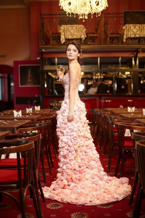 Bride in unusual wedding dress in restaurant stock image