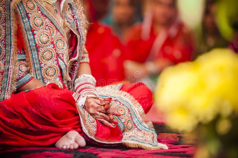 Bride wearing bangle bracelet. Punjabi bride's hands, fully decorated with henna decoration wearing bangle bracelet on her wedding day stock images