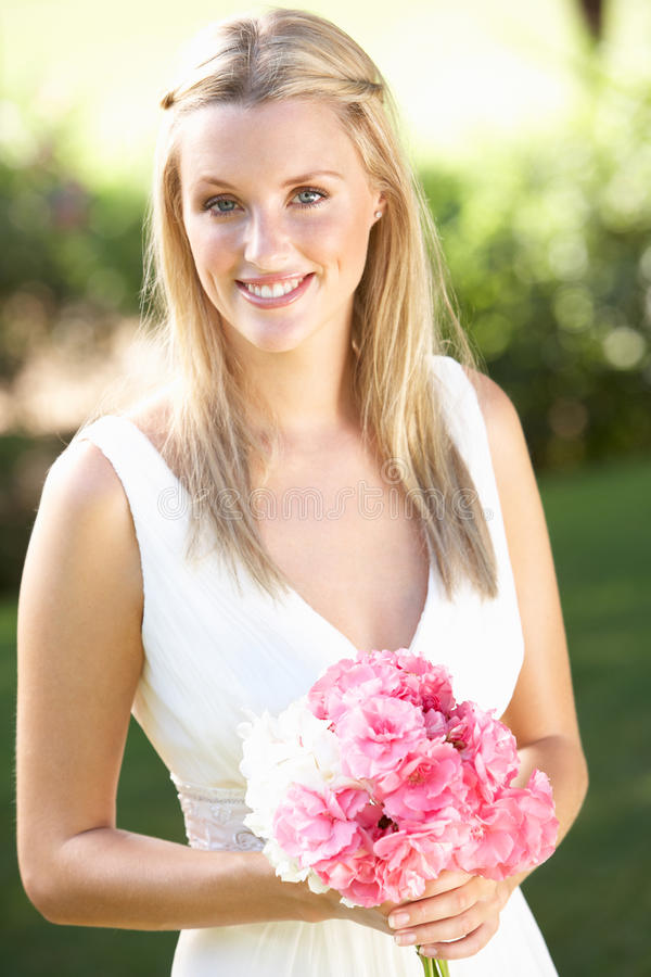 Bride Wearing Dress Holding Bouqet At Wedding. Smiling stock photography