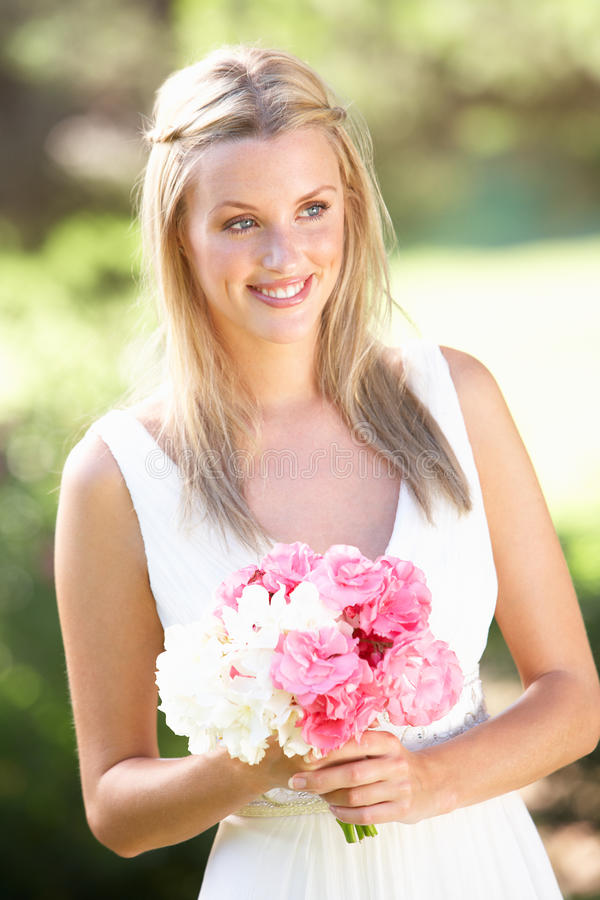 Bride Wearing Dress Holding Bouqet At Wedding. Smiling royalty free stock image
