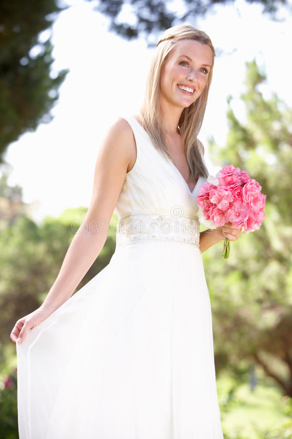 Bride Wearing Dress Holding Bouqet At Wedding. Smiling royalty free stock photography