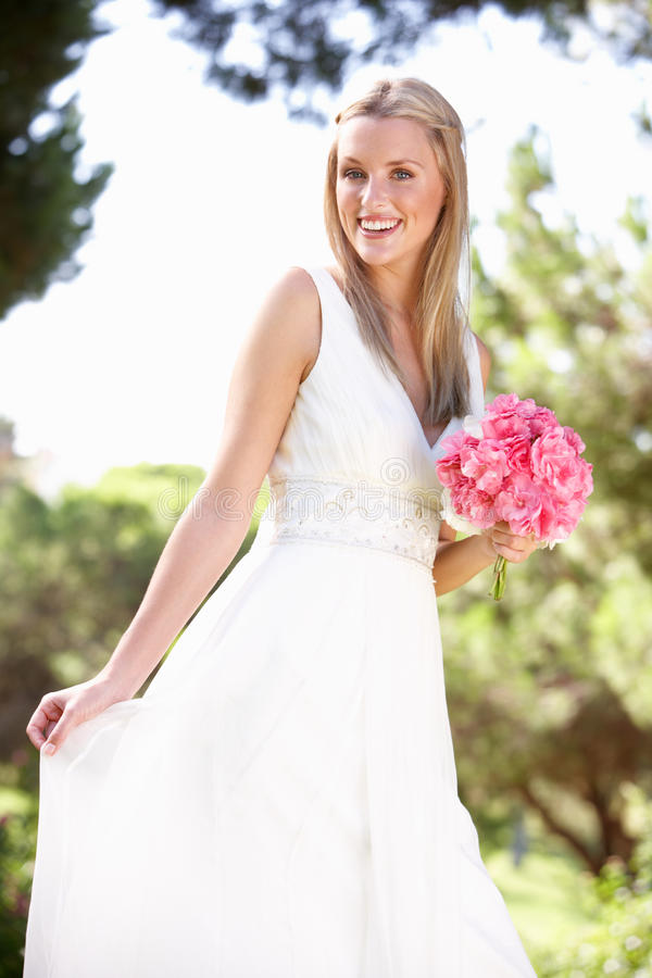 Download Bride Wearing Dress Holding Bouqet At Wedding Stock Image - Image of young, ceremony: 17063281