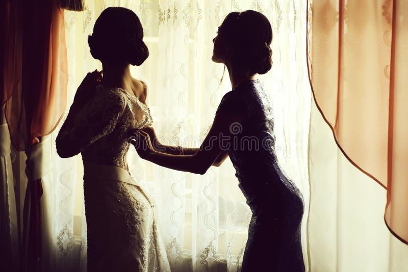 Bride wearing dress stock photos