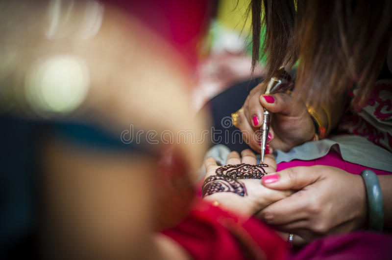 Bride wearing henna. Punjabi bride's hands, fully decorated with henna for her wedding day royalty free stock image
