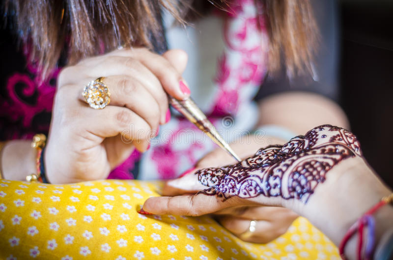 Bride wearing henna. Punjabi bride's hands, fully decorated with henna for her wedding day royalty free stock images