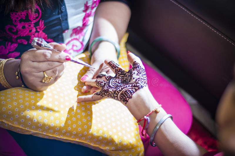 Bride wearing henna. Punjabi bride's hands, fully decorated with henna for her wedding day stock image