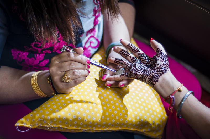 Bride wearing henna. Punjabi bride's hands, fully decorated with henna for her wedding day royalty free stock photo