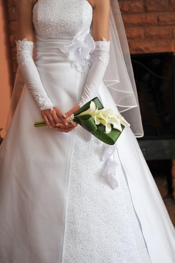Bride wearing wedding dress royalty free stock photos