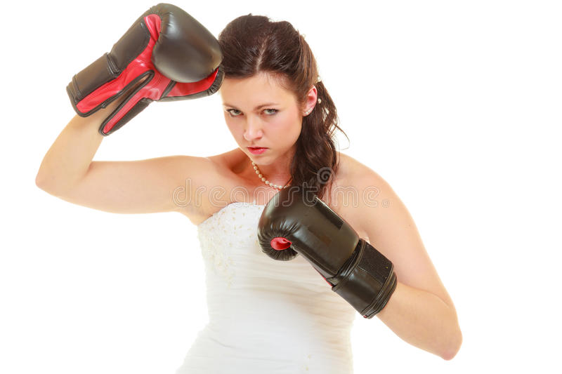 Bride wearing wedding dress and boxing gloves stock photography